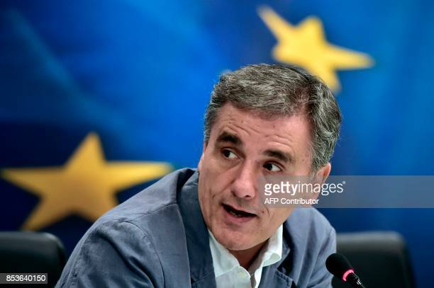 Greek Finance Minister Euclid Tsakalotos addresses a joint press conference with the Chair of the Eurogroup finance ministers during a joint press...