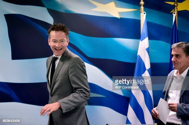 Greek Finance Minister Euclid Tsakalotos and the Chair of the Eurogroup finance ministers Jeroen Dijsselbloem arrive for their joint press conference...