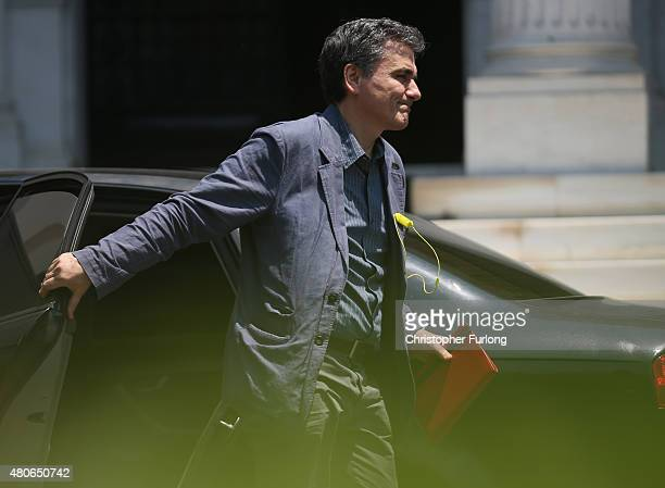 Greek finance minister Euclid Tsakalotos arrives at Maximos Mansion the residence of Greek Prime Minister Alexis Tsipras on July 14 2015 in Athens...