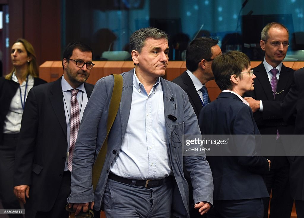 Greek Finance Minister Euclid Tsakalotos arrives for a Eurogroup meeting at the European Union headquarters in Brussels on May 24, 2016. Eurozone finance ministers said they hoped to unlock vital bailout cash for Greece on May 24, but warned of tough talks on debt relief that the IMF has demanded as the price for staying with the programme. / AFP / JOHN