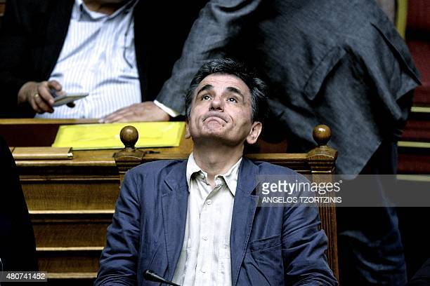 Greek Finance Minister Euclid Tsakalotos attends a parliament session in Athens on July 15 2015 Greece geared up for a parliamentary vote on...