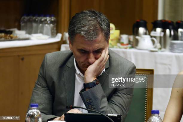 Greek Finance Minister Euclid Tsakalotos during a Government cabinet meeting at Parliament in Athens on June 13 2017 about the extend of catastrophy...