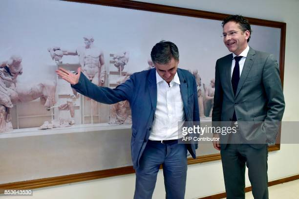 Greek Finance Minister Euclid Tsakalotos greets the Chair of the Eurogroup finance ministers Jeroen Dijsselbloem for their meeting on September 25...