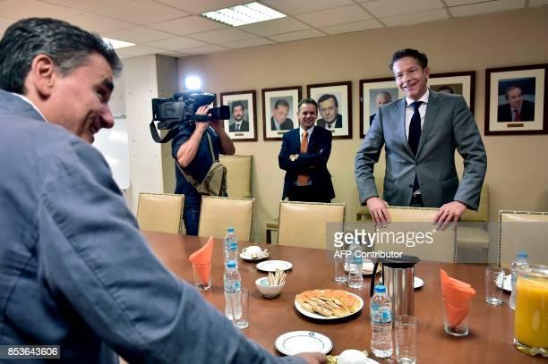 Greek Finance Minister Euclid Tsakalotos greets the Chair of the Eurogroup finance ministers Jeroen Dijsselbloem for their meeting on September 25...
