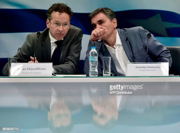 Greek Finance Minister Euclid Tsakalotos listens speaks to the Chair of the Eurogroup finance ministers Jeroen Dijsselbloem during their joint press...