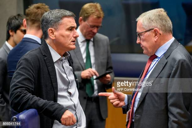 Greek Finance Minister Euclid Tsakalotos talks with Chief of the European Stability Mechanism Klaus Regling during a Eurozone Finance ministers...