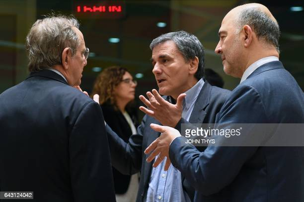 Greek Finance Minister Euclid Tsakalotos talks with Italian Minister of Economy and Finance Pier Carlo Padoan and EU Commissioner of Economic and...