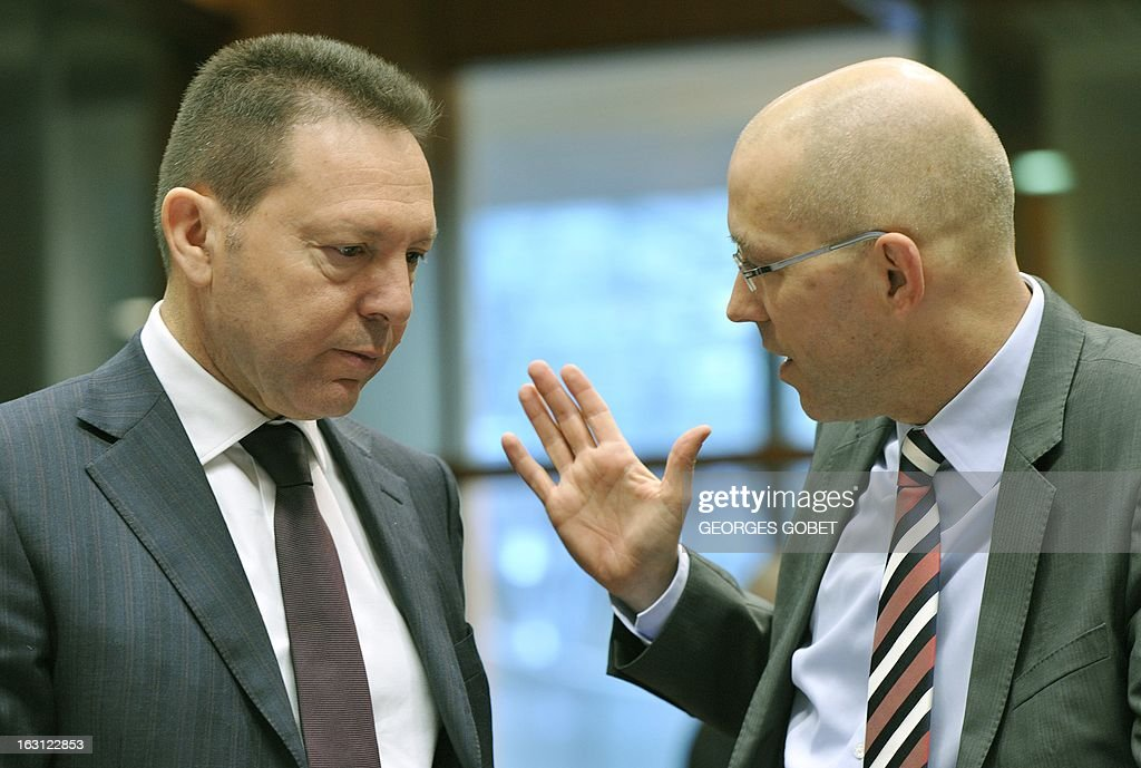 Greek Finance Minister Ioannis Stournaras (L) listens to European Central Bank (ECB) board member Jorg Asmussen prior to an Economic and Financial Affairs Council on March 5, 2013 at the EU Headquarters in Brussels. The Council will take note of progress on a draft directive on bank recovery and resolution, a proposal that is part of a broader plan to establish a banking union. It will also examine a package of measures aimed at combating VAT fraud – the 'quick reaction mechanism' and the 'reverse charge mechanism' – and will be called on to adopt conclusions.