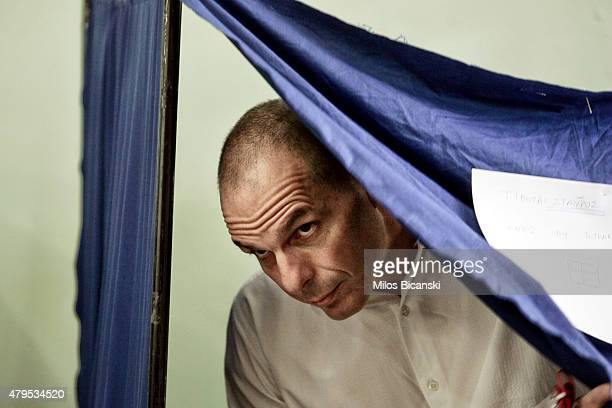 Greek Finance Minister Yanis Varoufakis leaves the voting booth after casting his vote in the referendum at a school in the suburbs of Athens on July...