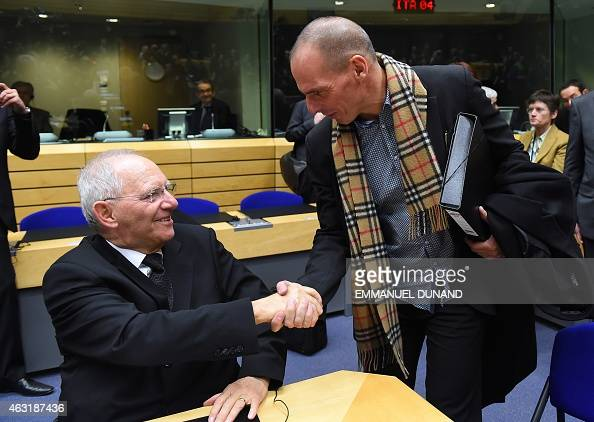 Greek Finance minister Yanis Varoufakis shakes hands with German Finance Minister Wolfgang Schauble during an emergency Eurogroup finance ministers...