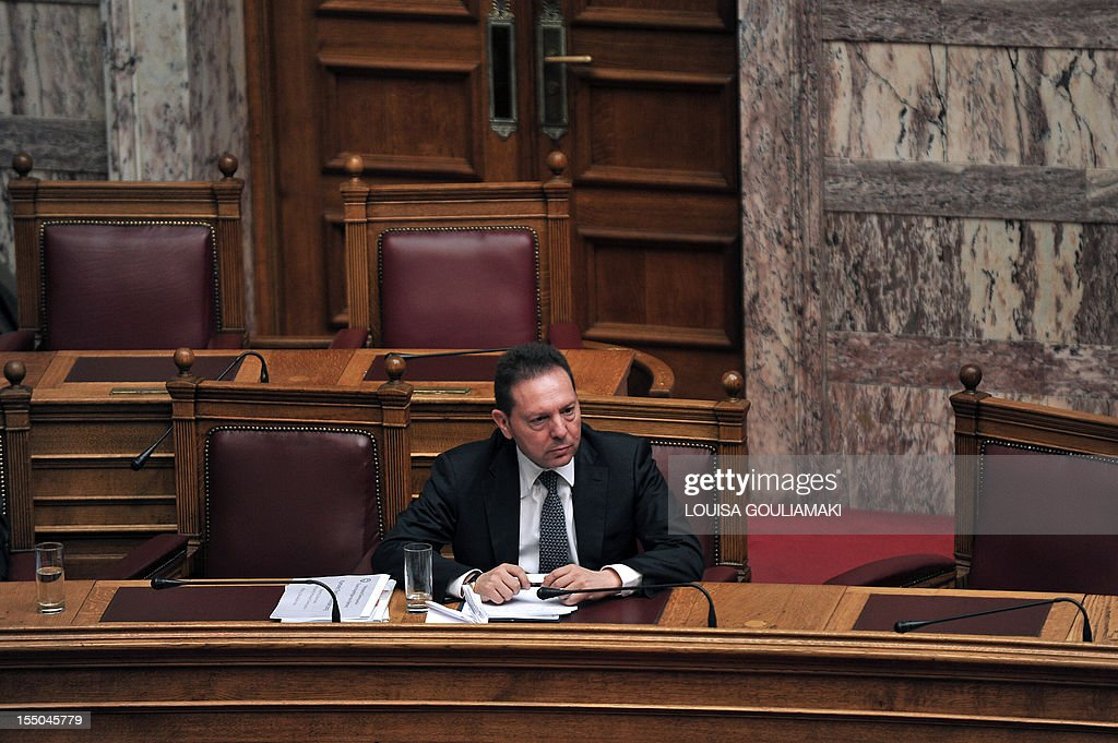 Greek Finance Minister Yannis Stournaras sits at the Greek parliament during a presentation of a draft budget to parliament outlining new austerity measures needed to unlock fresh rescue loans on October 31, 2012 in Athens. Greece revised downwards its recovery forecasts in a 2013 budget that predicted an economic contraction of 4.5 percent of output and a public deficit of 5.2 percent.