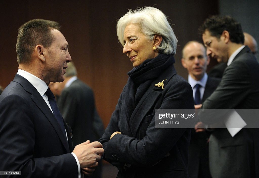 Greek Finance minister Yannis Stournaras (L) speaks with International Monetary Fund (IMF) Managing Director Christine Lagarde before an Eurogroup Council meeting on February 11, 2013 at EU Headquarters in Brussels. Dutch Finance Minister Jeroen Dijsselbloem holds his first eurozone meeting today, just as hard-won measures to stabilise the bloc pose a different problem, a strong euro dampening the economy.