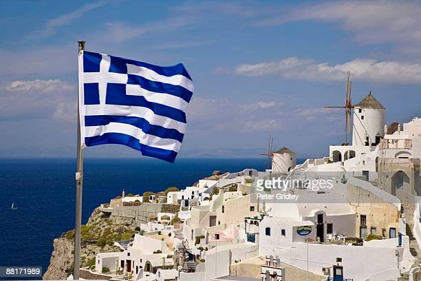 'Greek flag over village,  Santorini,  Greece'