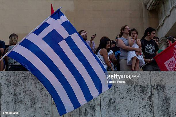 Greek flag waves during the demonstration Greeks demonstrate against austerity prior to Monday's 22nd July Eurogroup which is possible to decide if...