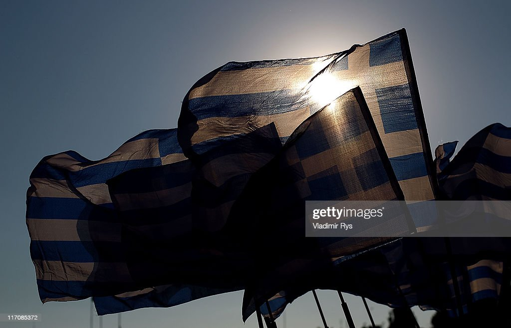 Greek flags are seen on a Syntagma (Constitution) square in the center of Athens on June 21, 2011 in Athens, Greece. Eurozone finance ministers are currently seeking to find a solution to Greece's pressing debt problems, including the prospect of the country's inability to meet its financial obligations unless it gets a fresh, multi-billion Euro loan by July 1. Greece's increasing tilt towards bankruptcy is rattling worldwide financial markets, and leading economists warn that bankruptcy would endanger the stability of the Euro and have dire global consequences.