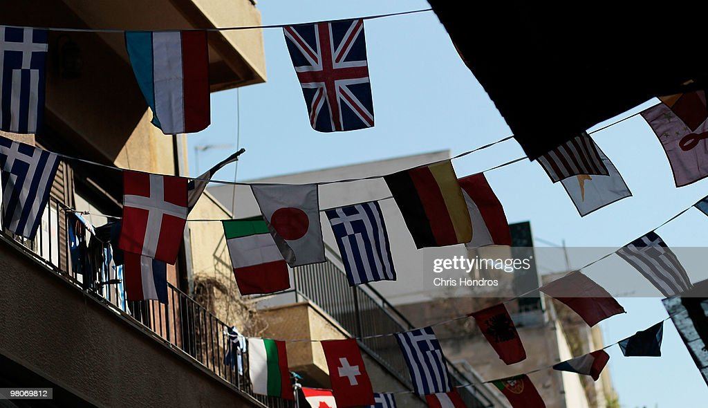 Greek flags hang with other world flags in the Plaka neighborhood March 26, 2010 in Athens, Greece. Leaders of the sixteen euro zone countries along with the International Monetary Fund agreed March 26 to provide Greece with a 22 billion euro loan to help the country with its staggering debts, though it will only be available if open market lending to Greece dries up.
