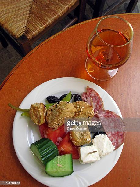 Greek Food and Drink. Glass of Brandy and Meze.