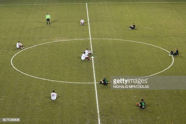 TOPSHOT Greek football players of AEL Larissa FC and Acharnaikos FC held a sitin protest at the start of a match in favor of migrants and refugges on...