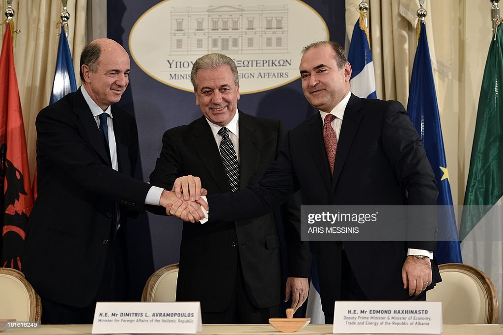 Greek Foreign Minister Dimitris Avramopoulos (C), Italian Minister of Economic Development Corrado Passera (L) and Albanian Depute Prime Minister and Minister of Economy, Trade and Energy Edmond Haxhinasto shake hands during the signing ceremony of the Trans Adriatic gas pipeline, in Athens on February 13, 2013. Greece, Italy and Albania signed a deal on backing for the Trans Adriatic Pipeline (TAP) project to carry natural gas from Azeri fields to Europe.