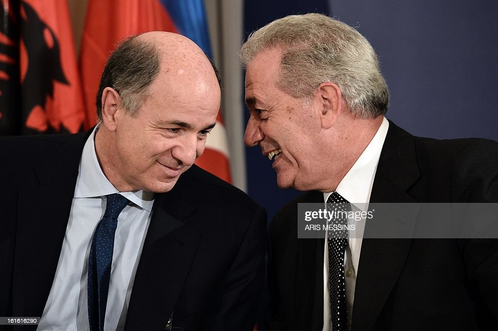 Greek Foreign Minister Dimitris Avramopoulos (R) speaks with Italian Minister of Economic Development Corrado Passera during the signing ceremony of the Trans Adriatic gas pipeline, in Athens on February 13, 2013. Greece, Italy and Albania signed a deal on backing for the Trans Adriatic Pipeline (TAP) project to carry natural gas from Azeri fields to Europe.