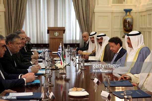 Greek Foreign Minister Evangelos Venizelos meets with Kuwaiti Foreign Minister Sheikh Sabah Al Khalid in Athens Greece on June 12 2014