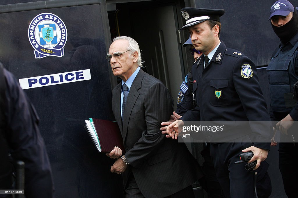 Greek former defence minister, Akis Tsohatzopoulos, arrives for a court trial in Athens on April 22, 2013. The trial of a prominent Greek 73-year-old socialist ex-minister, accused of money laundering over controversial arms deals, opened in a criminal court in Athens early today. Facing a sentence of up to 20 years, Tsochatzopoulos is accused of pocketing kickbacks on state contracts to buy a Russian-made anti-missile system and German submarines during his stint as defence minister.