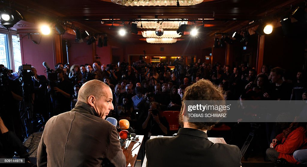 Greek former Finance Minister Yanis Varoufakis (L) and Croatian author Srecko Horvat address a news confernce on the official launch of the Democracy in Europe Movement (DiEM) in the Red Saloon, Volksbuehne Theater, in Berlin, on February 9, 2016. / AFP / TOBIAS SCHWARZ