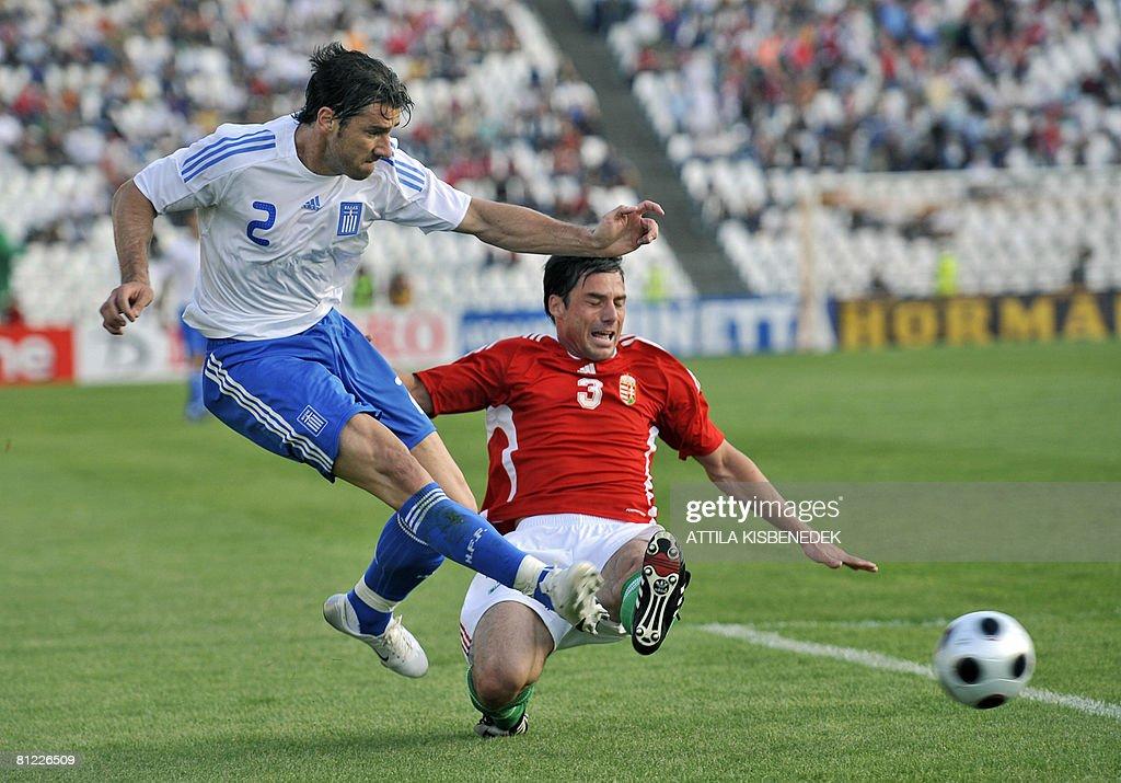 Greek Georgios Seitaridis vies with Hungarian Zsolt Low during their UEFA Euro 2008 warmup friendly football match on May 24 2008 in Puskas Stadium...