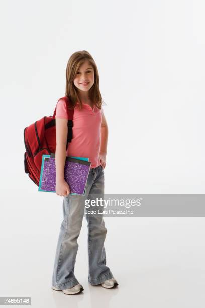 Greek girl carrying school books