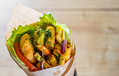 greek gyros with Fried Shrimp, tzatziki sauce, vegetables, feta cheese and french fries
