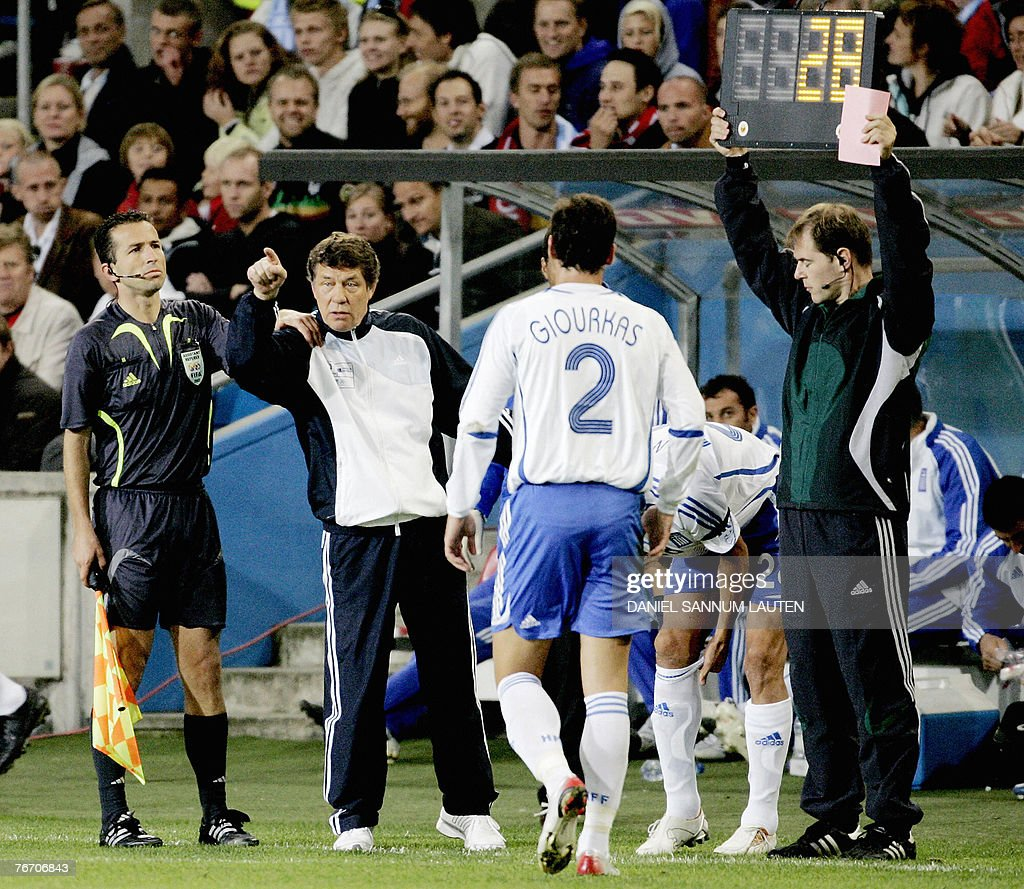 Greek headcoach Otto Rehhagel of Germany gestures to his players when Georgios Seitaridis leaves the pitch during the EURO 2008 Group C qualifying...