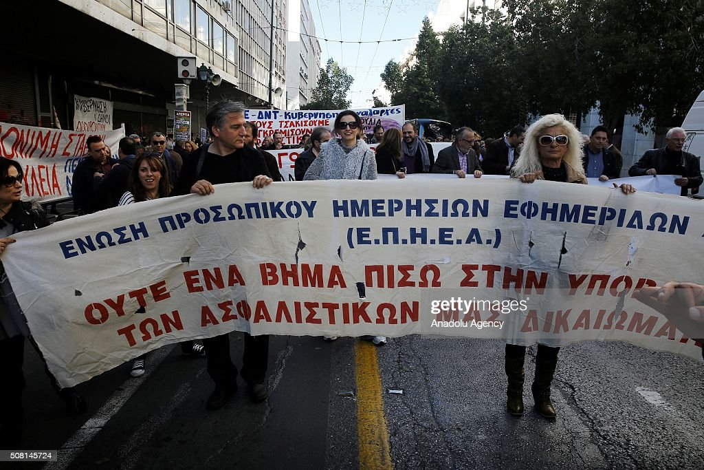 Greek journalists gather in front of Ministry of Labor as they go on a general strike set to disrupt services across the country to protest pension...