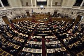 Greek lawmakers vote during the third round of a threestage presidential election at the Greek parliament in Athens on December 29 2014 Greece's...