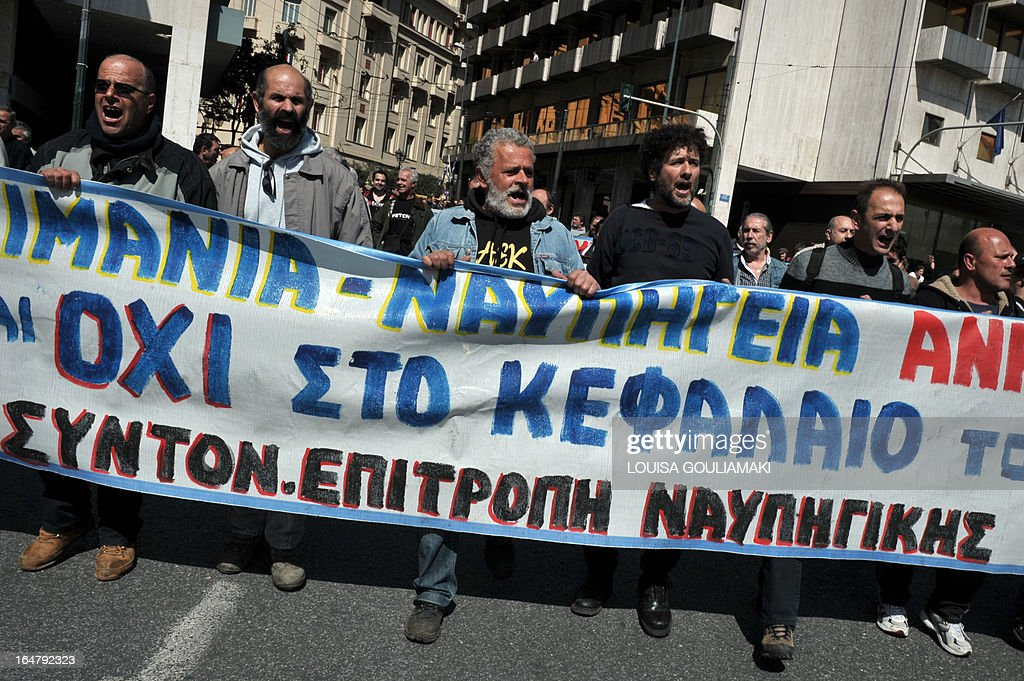 Greek metal workers march towards the Finance ministry in Athens on March 28, 2013 to protest the government's austerity measures and high unemployment in their sector. AFP PHOTO / LOUISA GOULIAMAKI