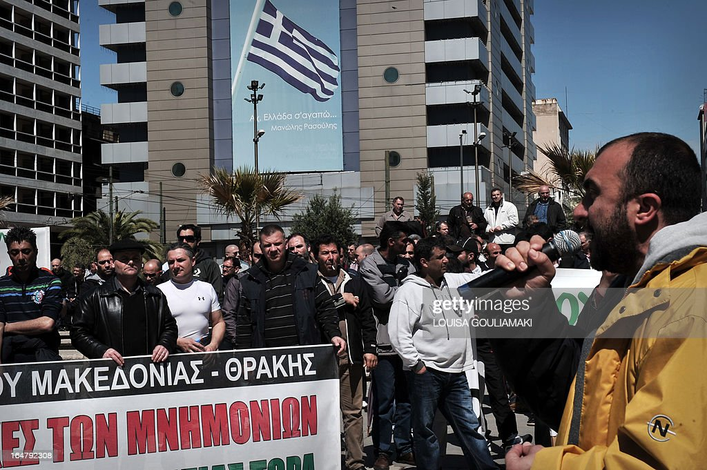 Greek metal workers rally at central Athens square on March 28, 2013 to protest the government's austerity measures and high unemployment in their sector. AFP PHOTO / LOUISA GOULIAMAKI