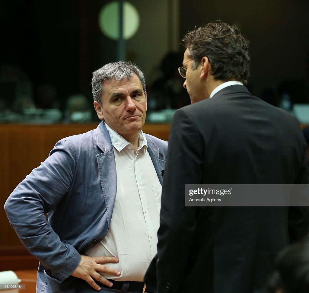 Greek Minister of Finance, Euclid Tsakalotos (L) and Eurogroup President, Jeroen Dijsselbloem (R) attend EU economic and financial council meeting, in Brussels, Belgium on May 25, 2016.