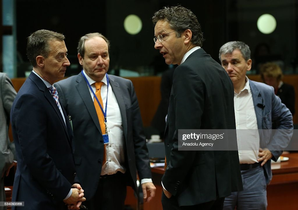 Greek Minister of Finance, Euclid Tsakalotos (R) and Eurogroup President, Jeroen Dijsselbloem (2nd R) attend EU economic and financial council meeting, in Brussels, Belgium on May 25, 2016.