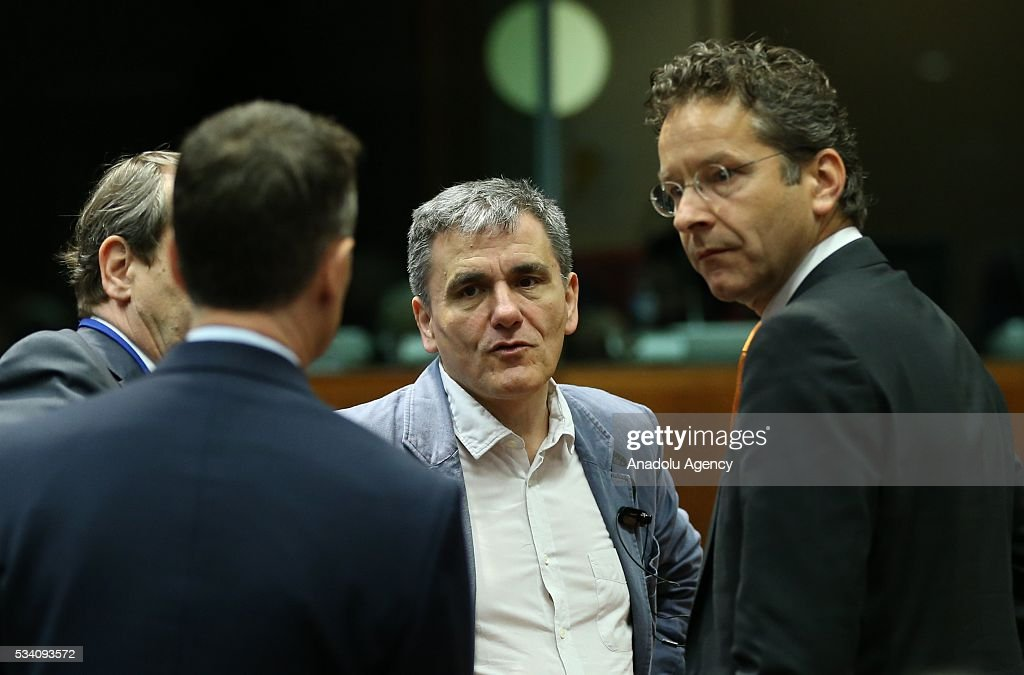 Greek Minister of Finance, Euclid Tsakalotos (2nd R) and Eurogroup President, Jeroen Dijsselbloem (R) attend EU economic and financial council meeting, in Brussels, Belgium on May 25, 2016.