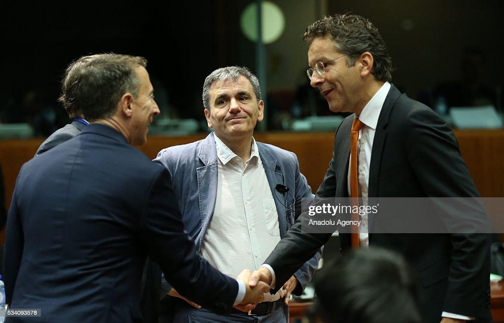 Greek Minister of Finance, Euclid Tsakalotos (2nd R) and Eurogroup President, Jeroen Dijsselbloem (R) attend EU economic and financial council meeting, in Brussels, Belgium on May 25, 2016.