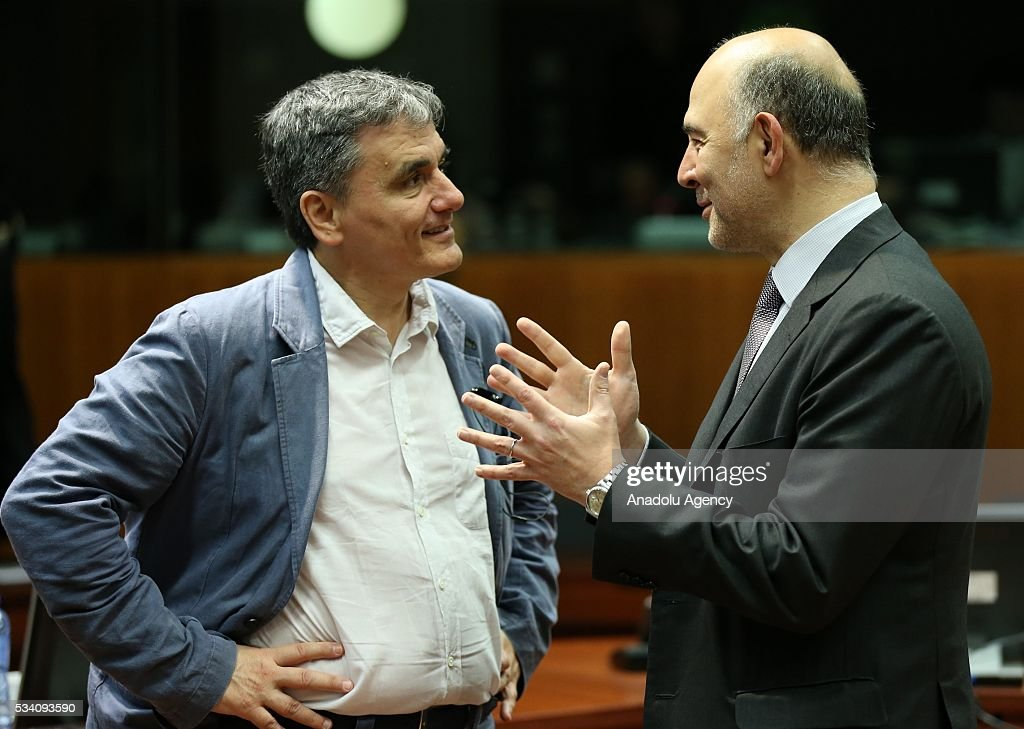 Greek Minister of Finance, Euclid Tsakalotos (L) and European Commissioner for Economic and Financial Affairs, Taxation and Customs, Pierre Moscovici (R) attend EU economic and financial council meeting, in Brussels, Belgium on May 25, 2016.
