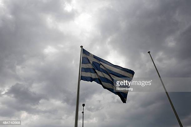 A Greek national flag flies outside the Athens Stock Exchange SA in Athens Greece on Friday Aug 21 2015 The return on Greek bonds this quarter...