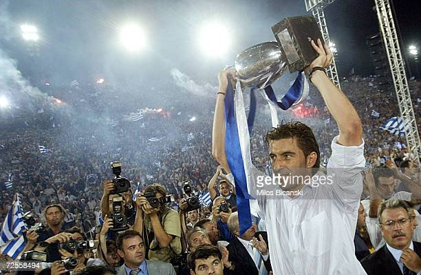 Greek national team captain Theodoros Zagorakis raises the trophy during a victory fiesta on July 5 2004 at Panathenaic Stadium in Athens Greece...