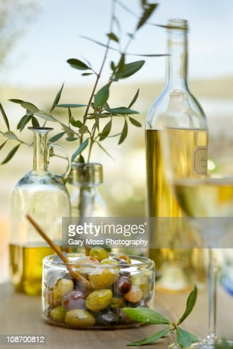 Greek olives in outdoor entertainment setting : Stock Photo