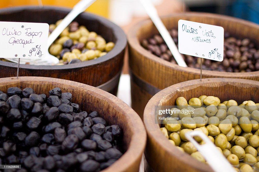Greek olives in wooden barrels
