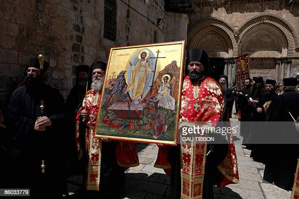 Greek Orthodox Bishops carry an icon showing the resurrection of Christ in front of the church of the Holy Sepulchre during the Easter Sunday...