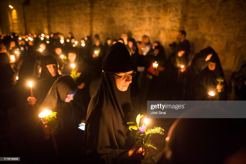 Greek Orthodox Christian nuns walk along the Via Dolorosa during a procession commemorating the death and the resurrection of Saint Maria on August 25, 2013 in Jerusalem's old city, Israel. A few hundred Christian orthodox believers walked from the Church of the Holy Sepulcher to Gethsemane Church as they took part in the procession.