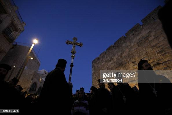 Greek Orthodox clergy wait for the arrival of Russian Orthodox Patriarch Kirill on November 9 2012 in Jerusalem's Old City Kirill arrived in...