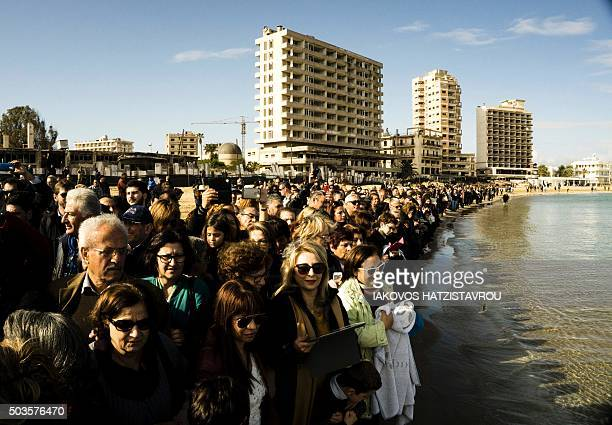 Greek Orthodox Cypriots attend the traditional 'Blessing of the Sea' ceremony in celebration for Epiphany on January 6 outside the fencedoff...
