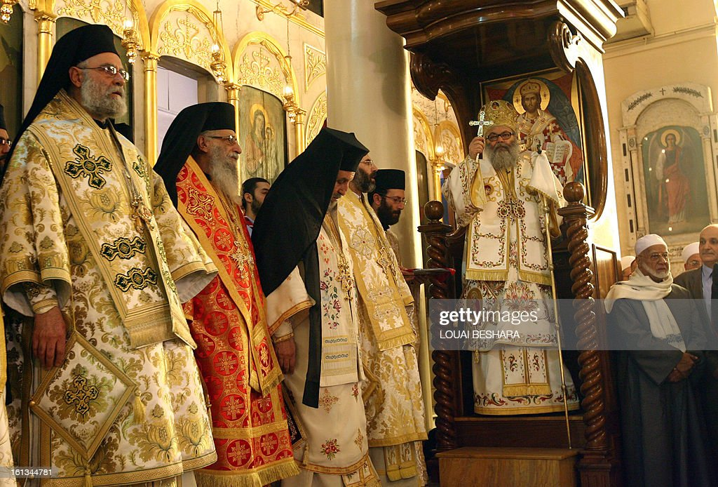 Greek Orthodox leader Yuhanna X Yazigi hold up a cross during his enthronement as the Greek Orthodox Patriarch of Antioch and All the East at the Holy Cross Church, in the Qasaa district of Damascus, on February 10, 2013. Yuhanna X Yazigi was chosen as the Patriarch of Antioch and All the East on December 17, replacing Ignatius IV Hazim who died that month. Christians make up about five percent of the population in Syria, where rebels and forces loyal to Syrian President Bashar al-Assad have been locked in a civil war the UN says has killed more than 60,000 people.