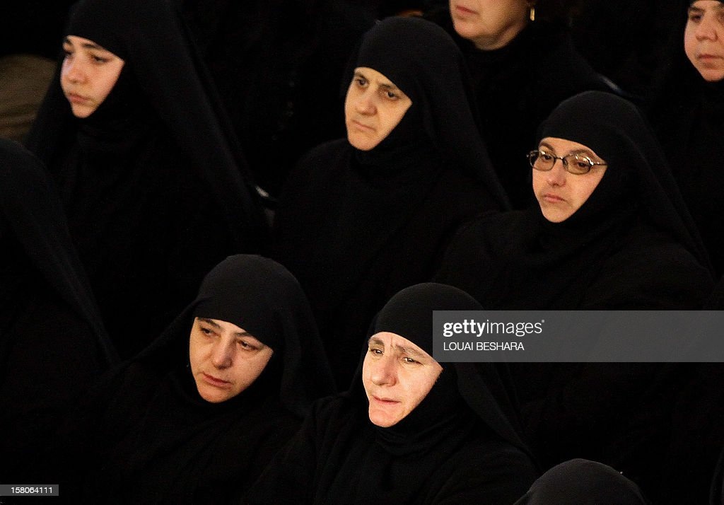 Greek Orthodox nuns attend the funeral of Greek Orthodox patriarch of Syria, Ignatius IV Hazim, at the Meriamiah Church in the Syrian capital Damascus on December 10, 2012. The patriarch died of a stroke in the Lebanese capital Beirut on December 5.